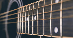 The fretboard of an acoustic guitar.