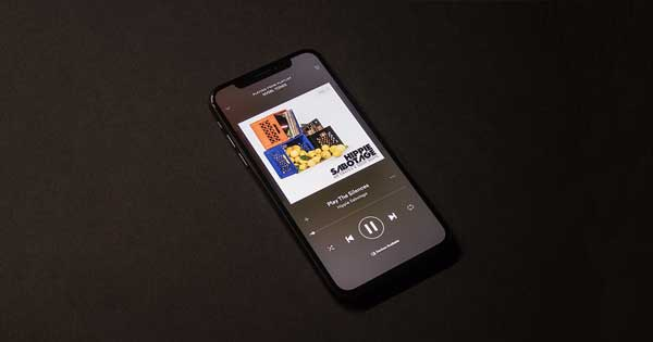 Music play through a phone's speakers.