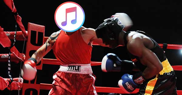 A boxer with an iTunes logo over his face, punching another boxer.