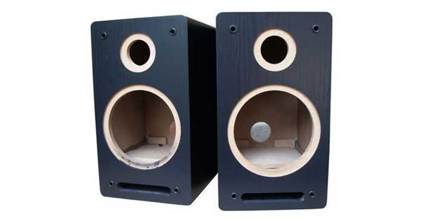 An image of two empty speaker cabinets.