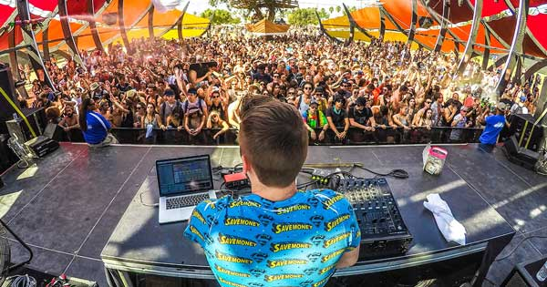 A DJ performing in front of a crowd.