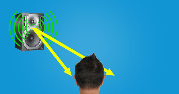 An image of sound waves traveling a shorter distance to reach a person's left ear than a person's right ear, creating a timing difference.