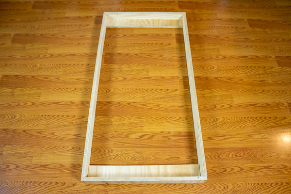 A front view of two support strips added to an acoustic panel frame.