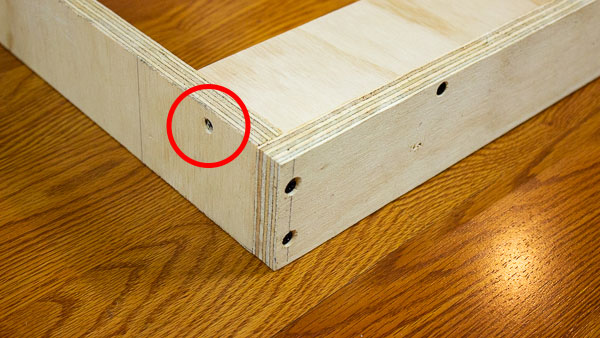 An image of additional stabilization added to a support strip using wood glue and a wood screw (red).