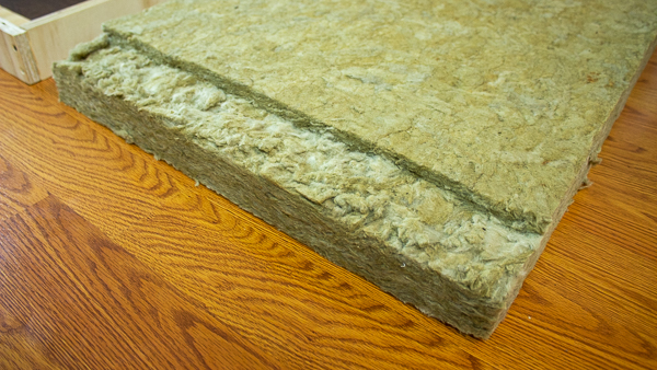 A close up view of insulation that has been cut to accommodate a support strip.