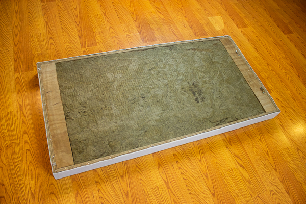An image of an acoustic panel completely wrapped in felt using an adhesive spray.