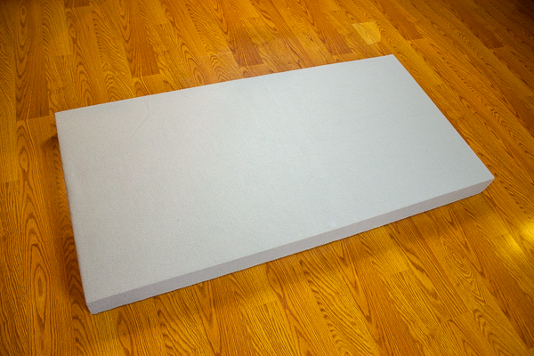 An image of the front side of an acoustic panel wrapped in felt.