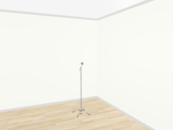 An image of a microphone set up in the corner of an untreated room.
