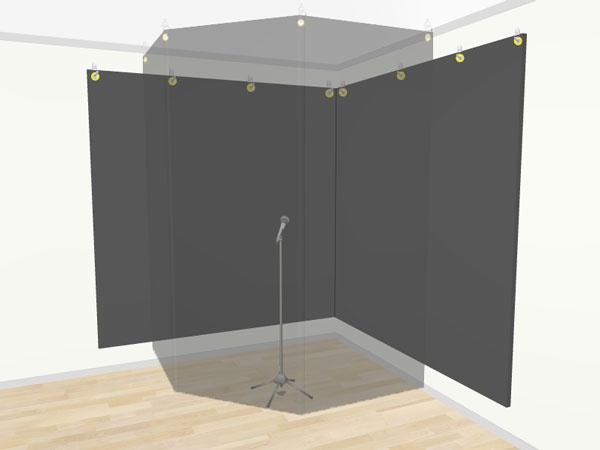 An image of a vocal recording booth set up in the corner of a room.