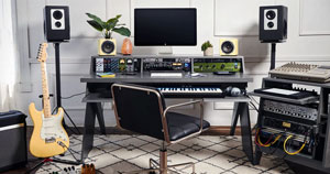 An Output Platform desk being used to house music production gear.