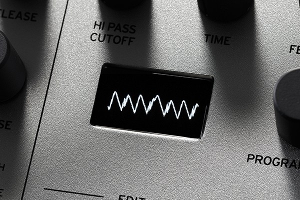 An image of the Minilogue's multi-purpose OLED screen displaying a waveform.