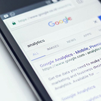 A screen shot of a phone with someone searching for analytics on google search.