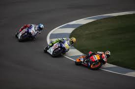 3 Superbikes racing at a grand prix