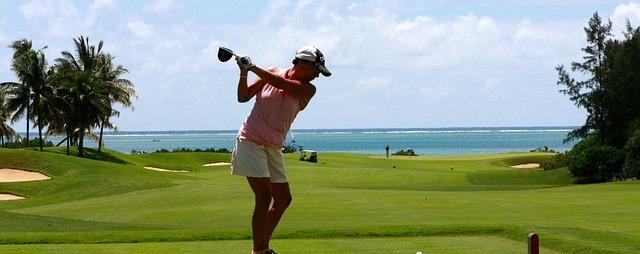 person swinging a golf club