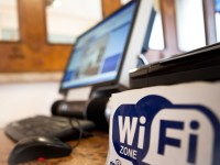 computer next to wifi logo