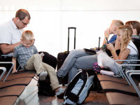 family sitting in an airport