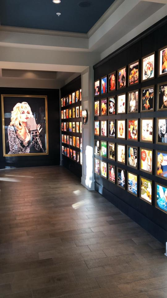 Dolly Parton's records and large portrait