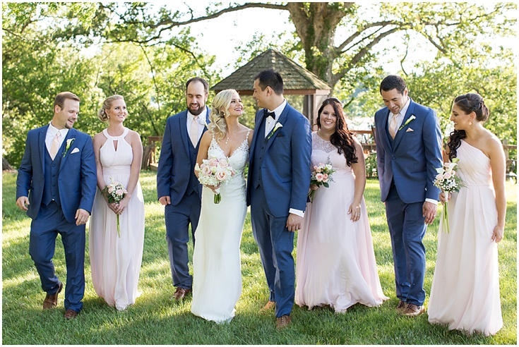 A wedding party poses for a picture at great oak manor in md