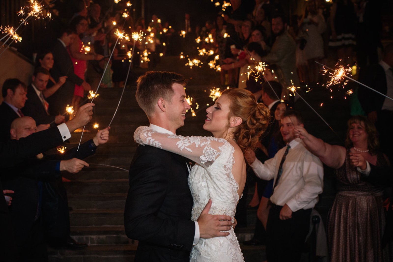 wedding couple in front of sparklers