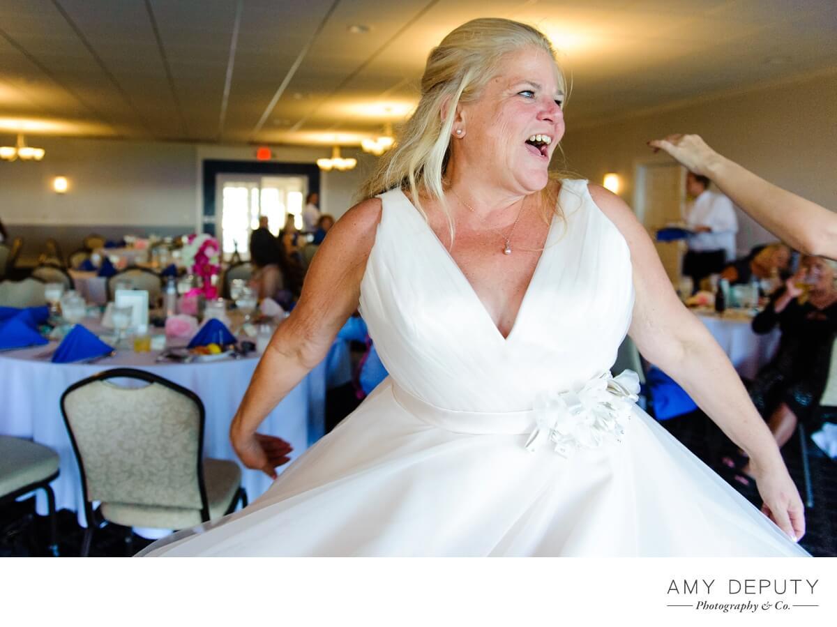 bride dancing at a kent island yacht club wedding