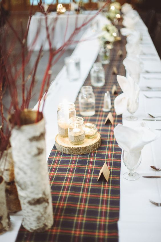 plaid table runners at wedding reception
