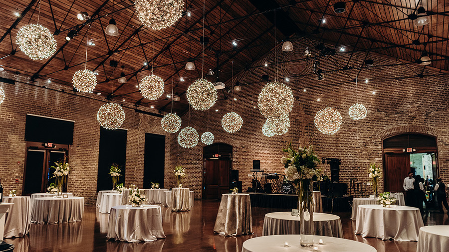 wedding reception with lighted ceiling snowballs