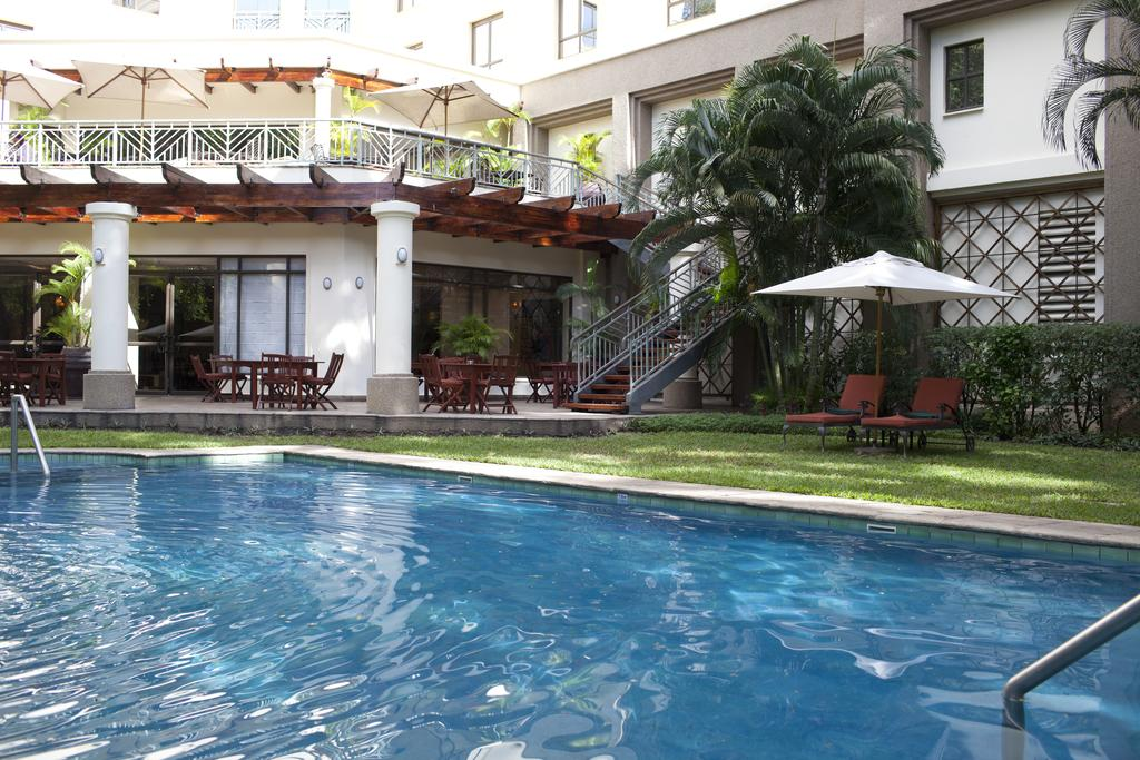 This upscale hotel is a 3-minute walk from the Julius Nyerere International Convention Centre.