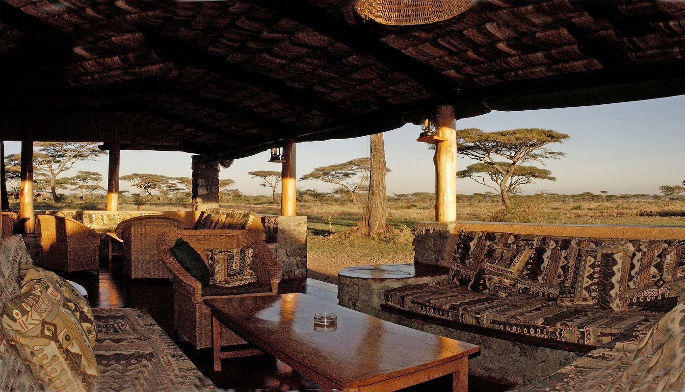 The Lodge nestles unobtrusively under a canopy of giant acacias with views towards Lake Ndutu.