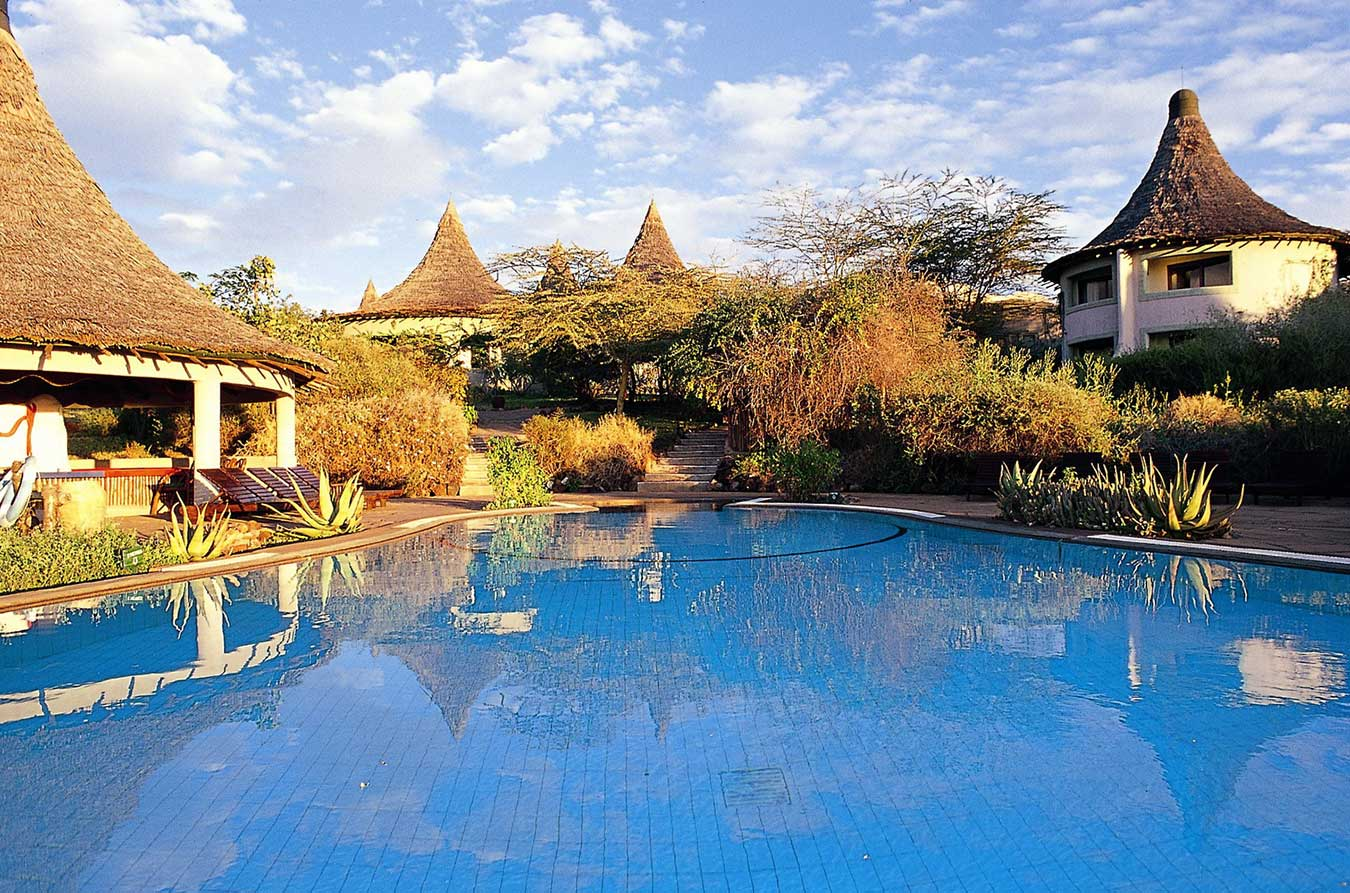 Grouped around a central 'vanishing horizon' pool, this highly unusual lodge features a simple timbered reception area, built in traditional African style
