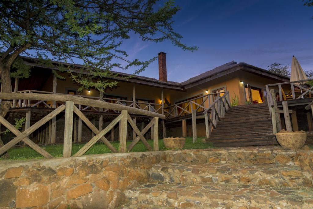 Perched high on the rim of the Great Rift Valley, Escarpment Luxury Lodge is a serene haven overlooking the wonder of Lake Manyara below.