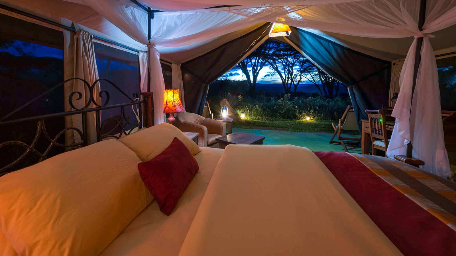 Lion's Paw Camp is nestled beneath a quiet grove of red thorn acacia trees, high atop the eastern rim of the Ngorongoro Crater.
