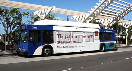 bus with an ad on the side of it
