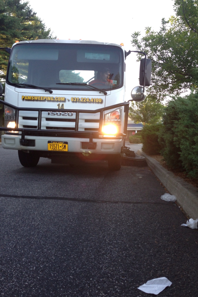 Street Sweeping truck on municipal street