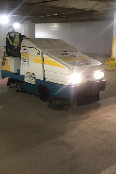 Parking garage sweeping machine