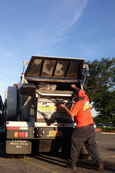Debris being removed by garbage truck