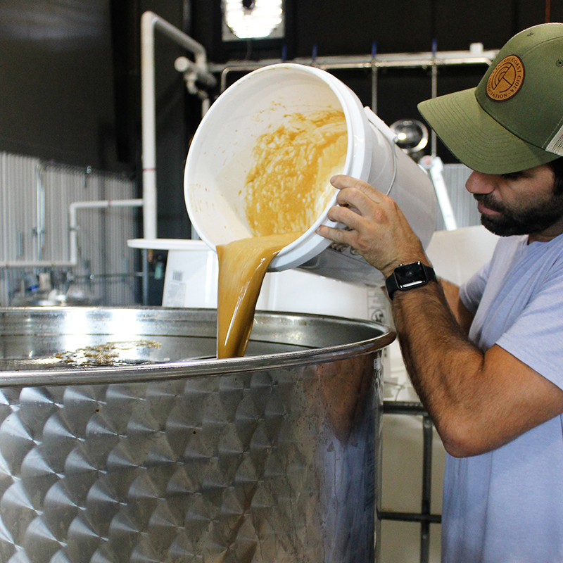 Distiller_pouring_yeast