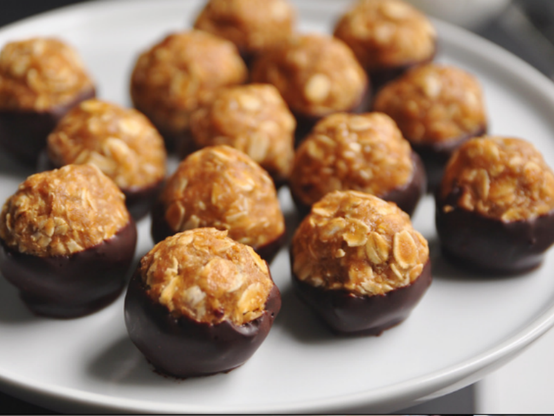 Peanut butter oatmeal buckeyes dipped in chocolate