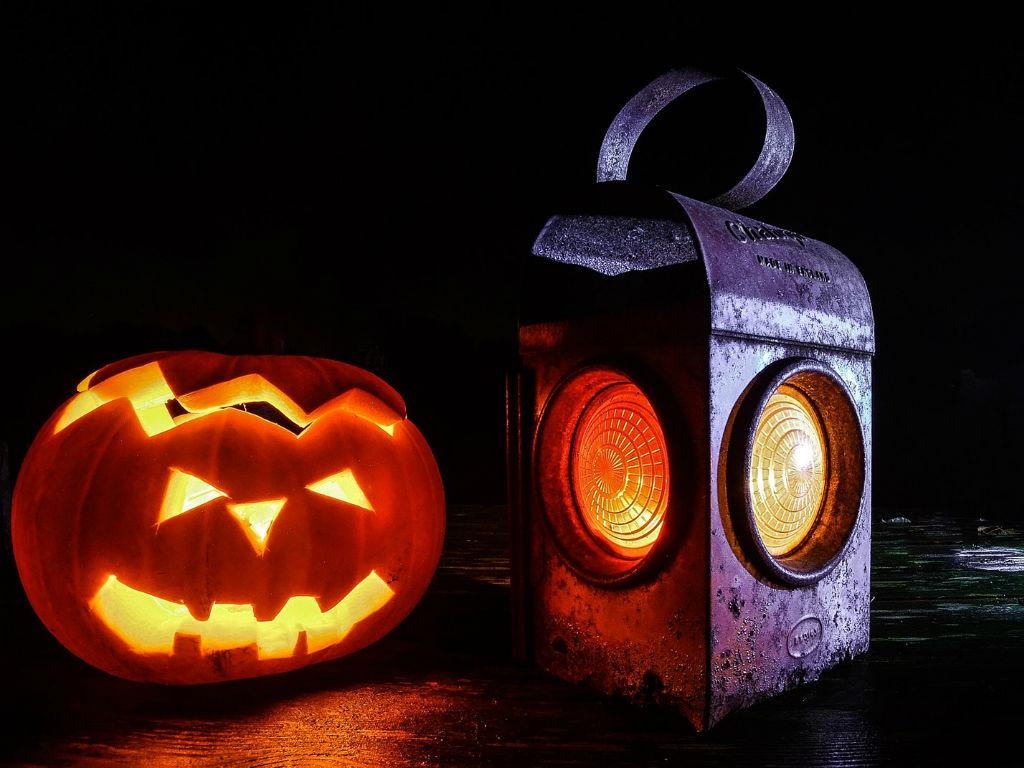 glowing jack-o-lantern next to a lantern