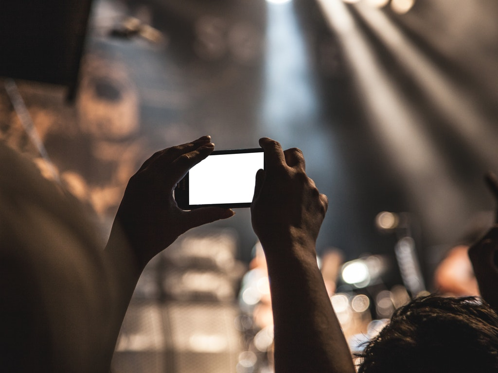 a person taking a picture with a phone