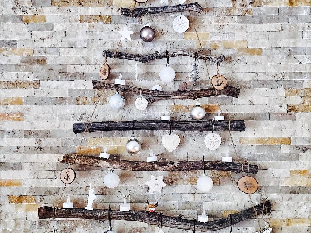 a minimalist christmas tree decoration on the wall