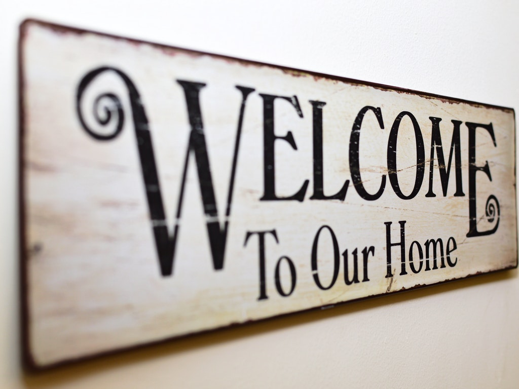 sign reading welcome to our home