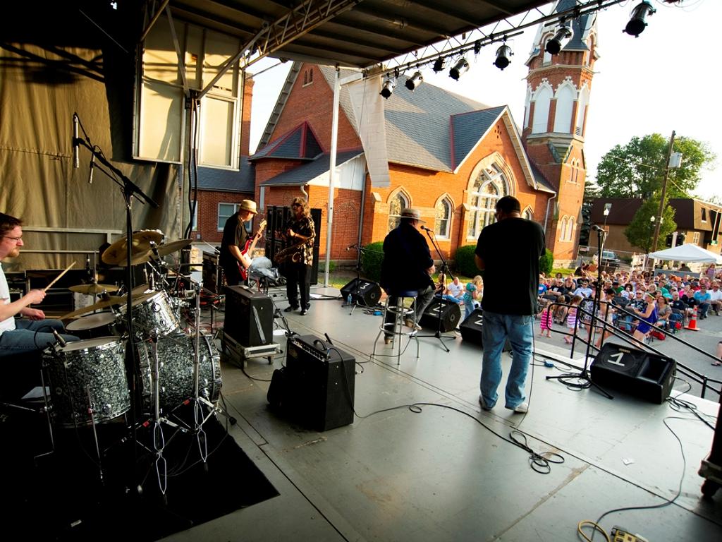 musicians preform on stage at creekside jazz festival