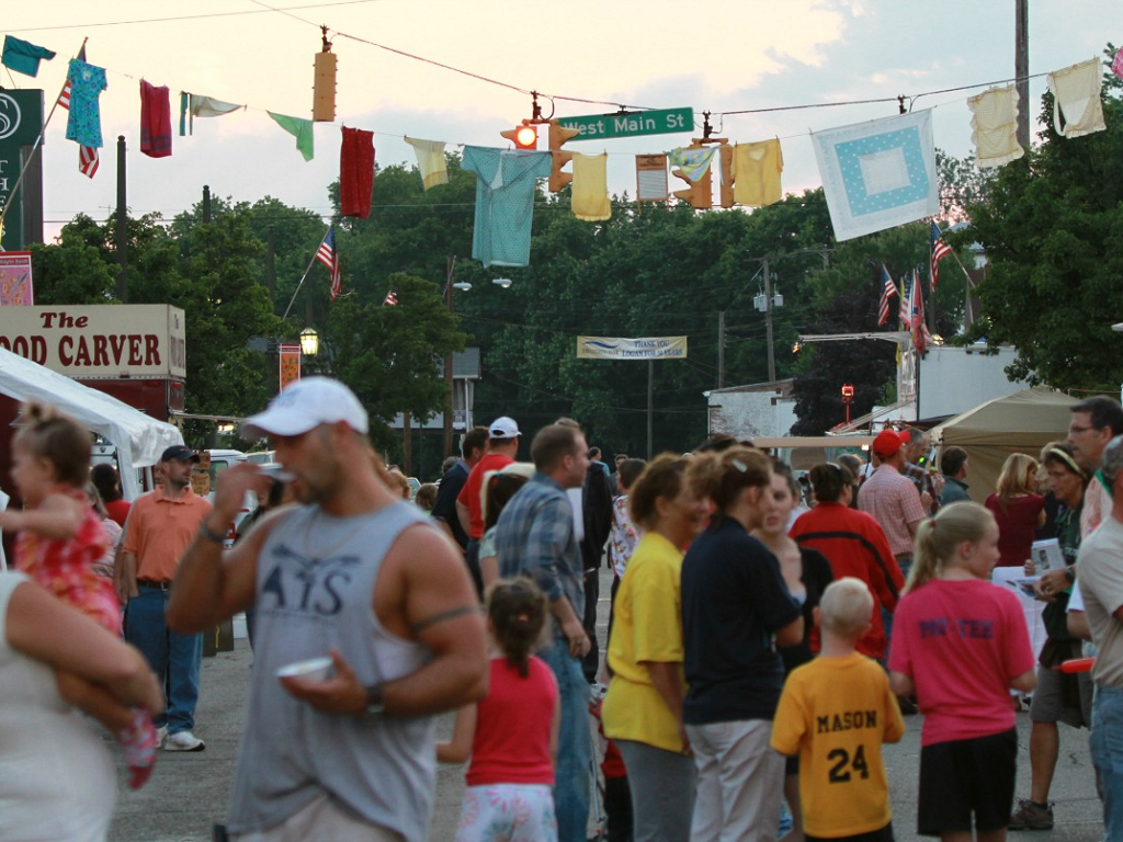 people gathered at logan's music festival