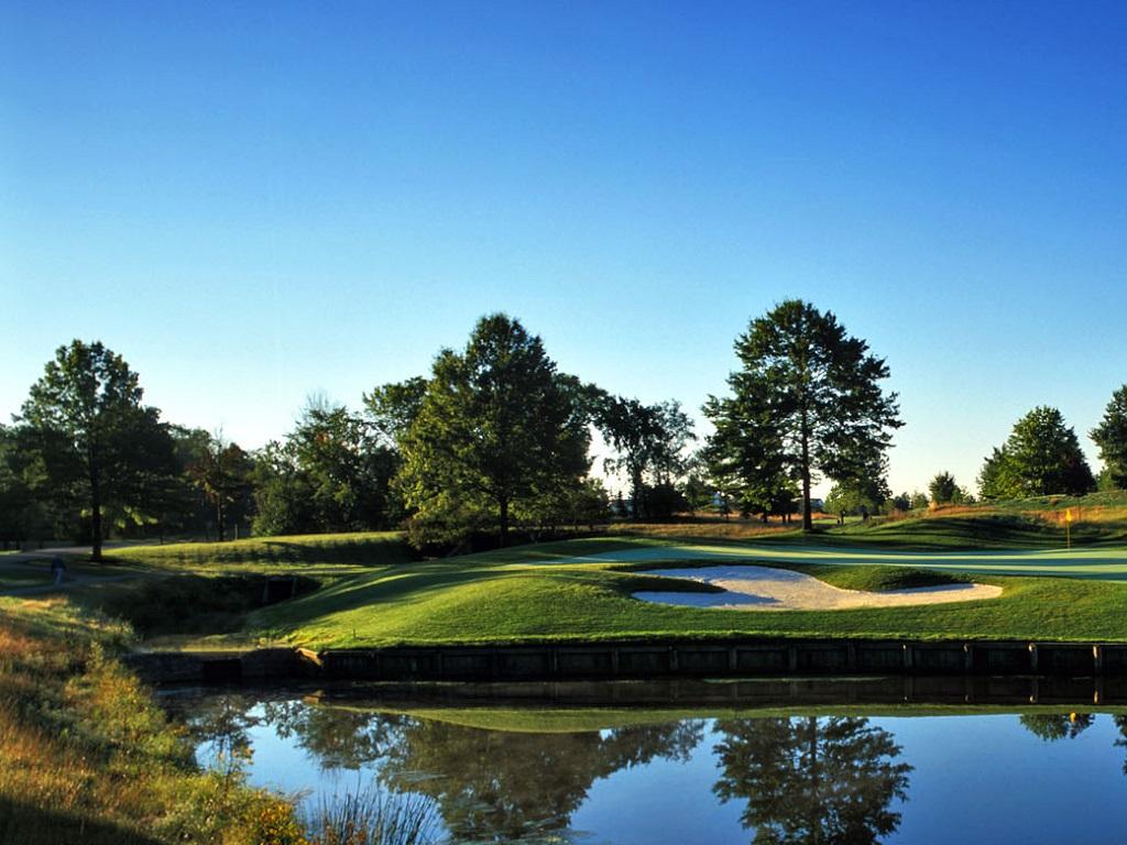 a golf course on a sunny day