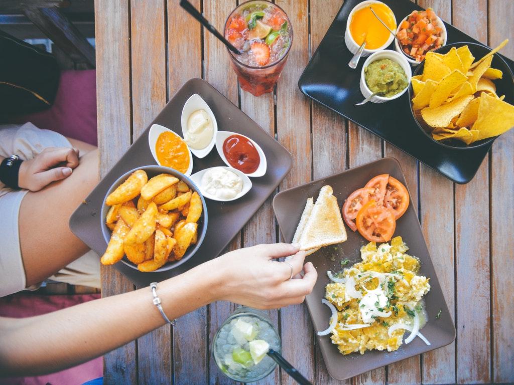 people sharing food at a 4th of july potluck