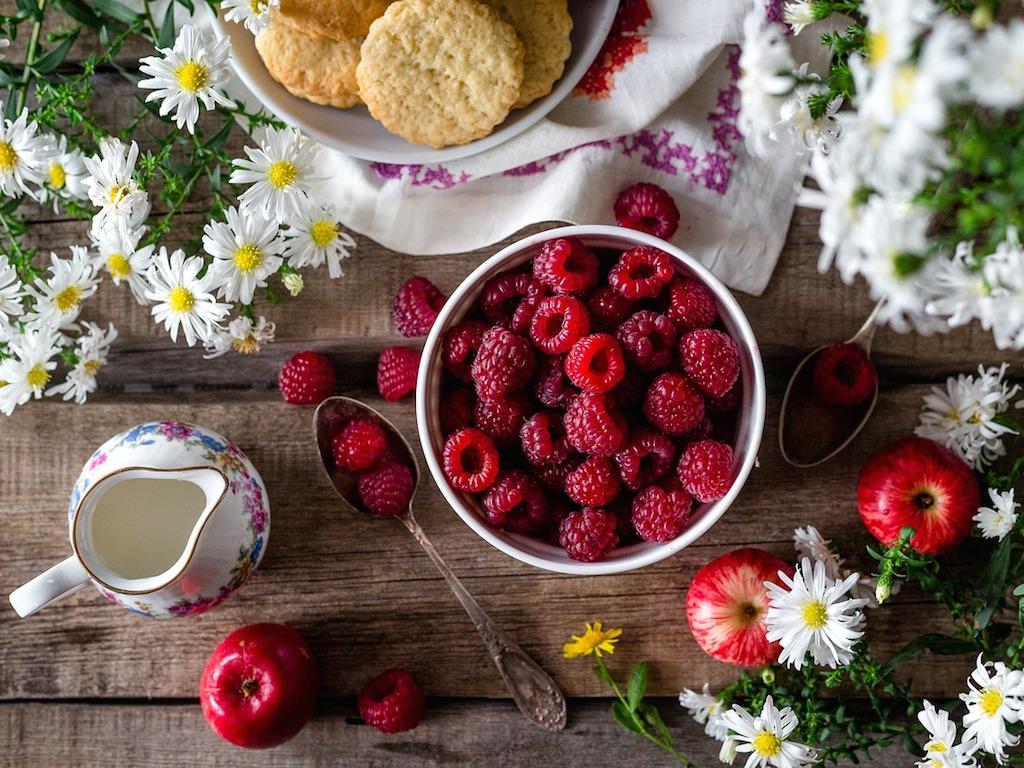 a bowl of freshly picked raspberries