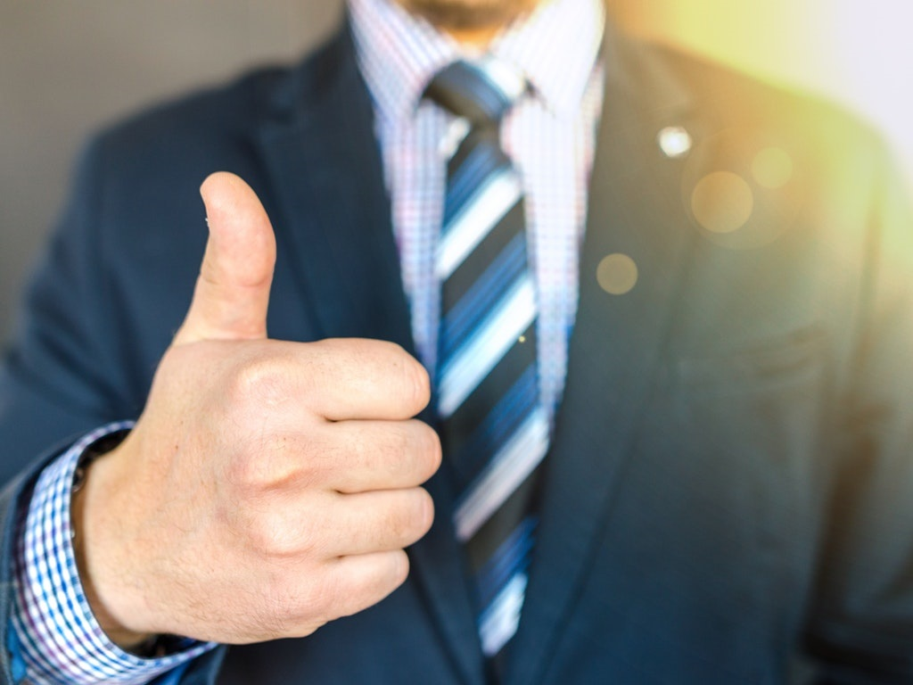 real estate agent giving a thumbs up