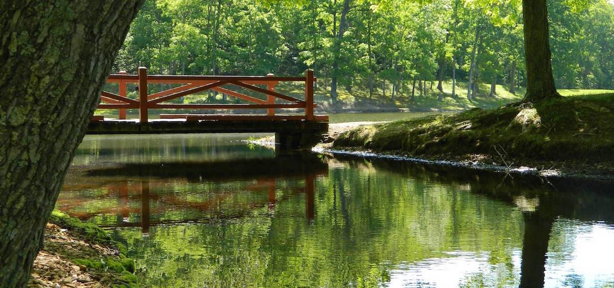a bridge over a river at scioto trail state park