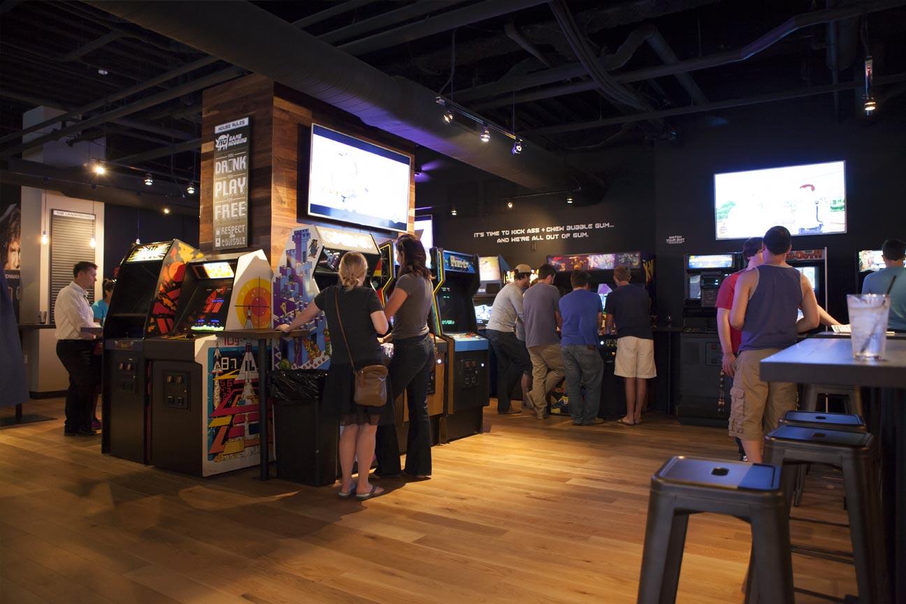 people playing arcade games at16-Bit Bar+Arcade