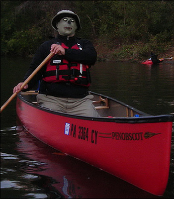 man dressed as a zombie in a canoe
